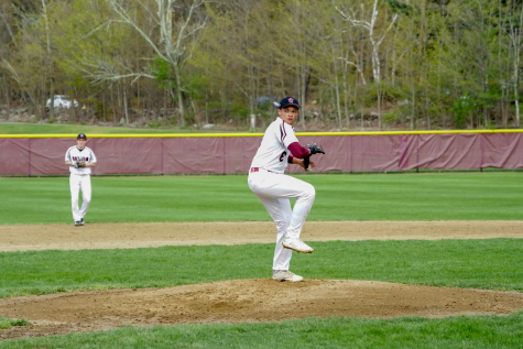 Senior Peter Messervy throws a pitch in a game against Acton-Boxbourough Regional High School